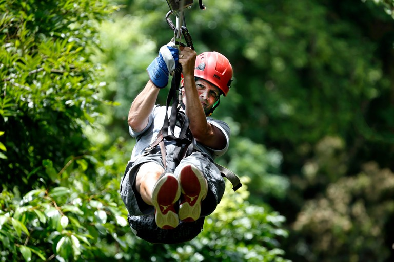 Man on zip line, Ecoquest Adventures & Tours, Hacienda Campo Rico, Carolina, Puerto Rico