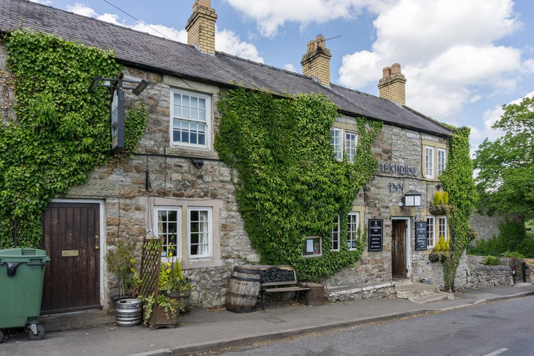The Packhorse Inn, a traditional country pub, in the village of Little Longstone, Derbyshire, UK
