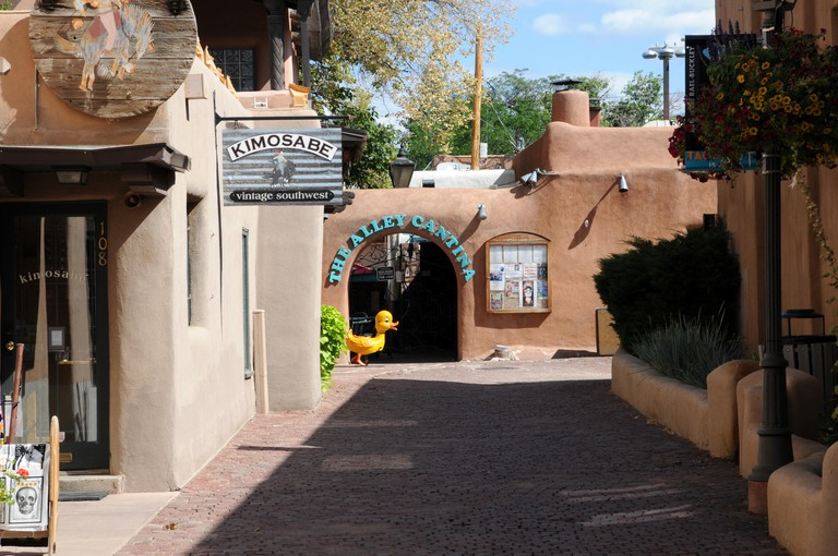 Buildings and shops in the adobe style just off of the plaza in Taos New Mexico.