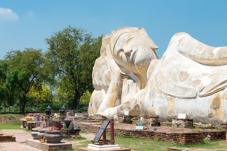 Ayutthaya, Thailand - Nirvana statue at WAT LOKAYA SUTHA in Ayutthaya, Thailand. It is part of the World Heritage Site - Historic City of