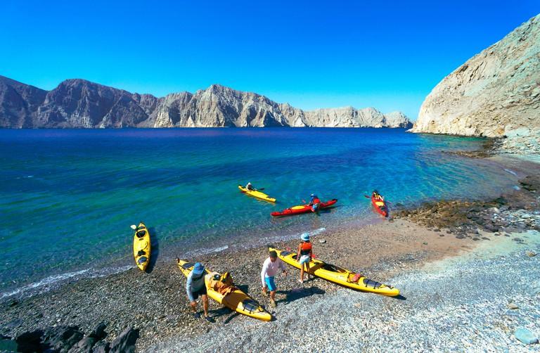 sea kayaking in bay of Sham in the Strait of Hormuz, Oman, Musandam, Khasab