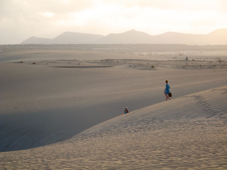 Corralejo sand dunes in sunset lowlight with children playing. Image shot 2010. Exact date unknown.