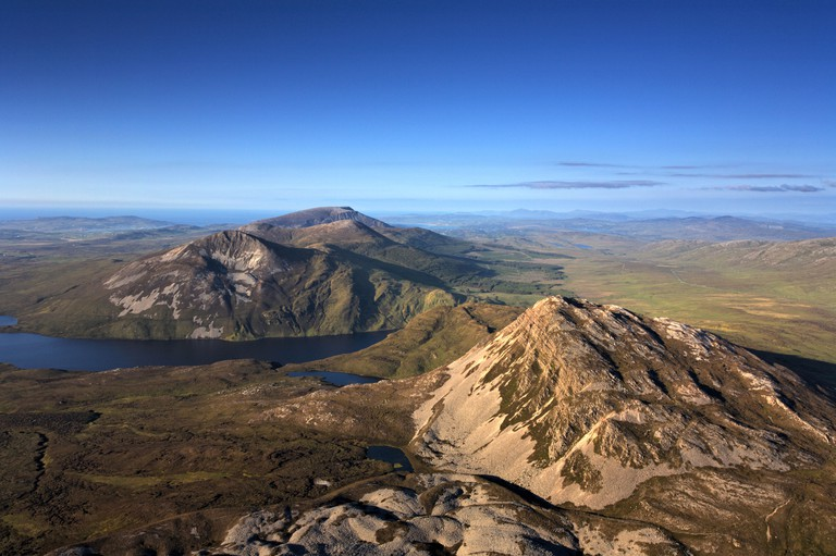 View from the summit of Mount Errigal in the range of Derryveagh Mountains in Glenveagh national park, Donegal, Southern Ireland