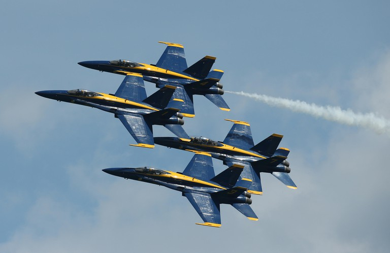 The U.S. Navy Blue Angels flight demonstration squadron performs during rehearsal before the 2017 Chicago Air and Water Show above North Avenue Beach