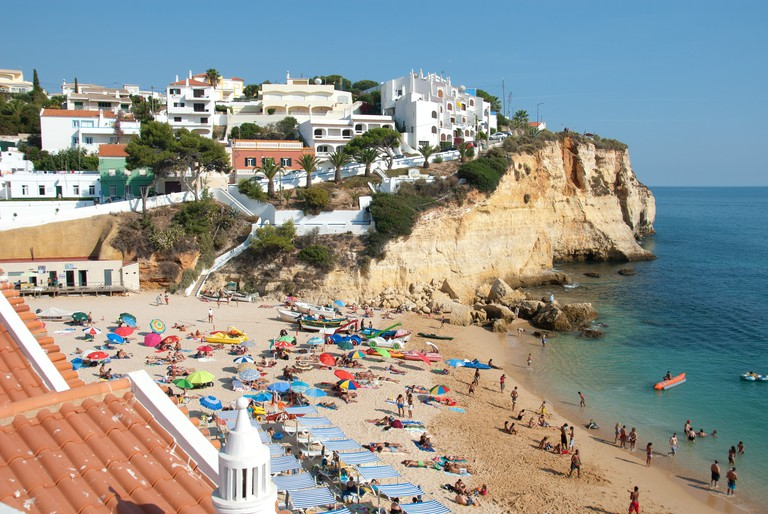 ALGARVE, PORTUGAL. A view of the beach and town at the holiday resort of Praia do Carvoeiro. 2012.