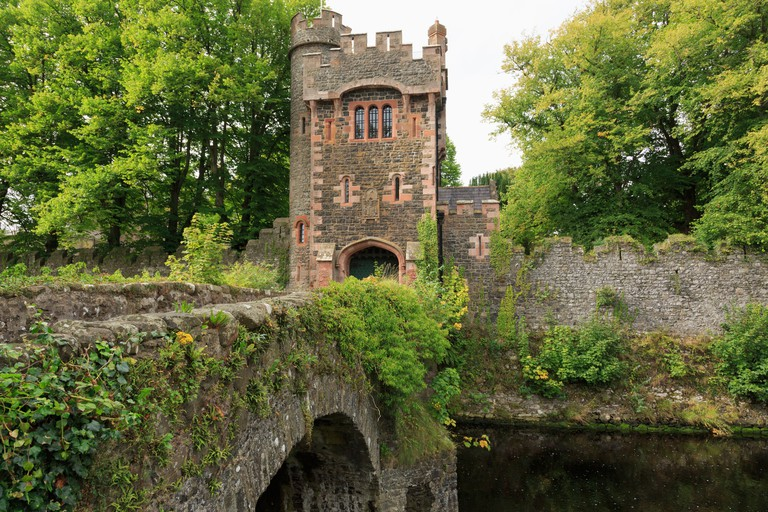 Bridge over Glenarm river to Barbican tower gate entrance to Glenarm Castle in Glenarm, County Antrim, Northern Ireland, UK, Britain