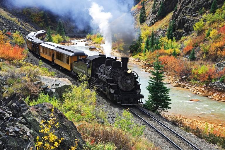 Durango & Silverton Narrow Gauge Railroad, Animas River and Fall colors, near Silverton, Colorado USA