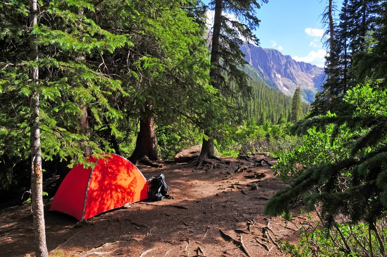 Camping scene with Tent in mountains