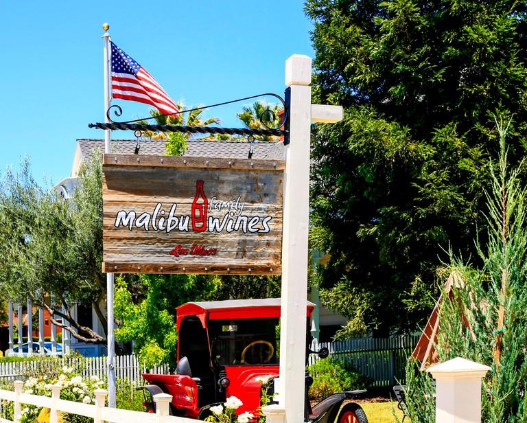 Malibu Wines swinging overhead sign outside their wine tasting store in Los Olivos in California