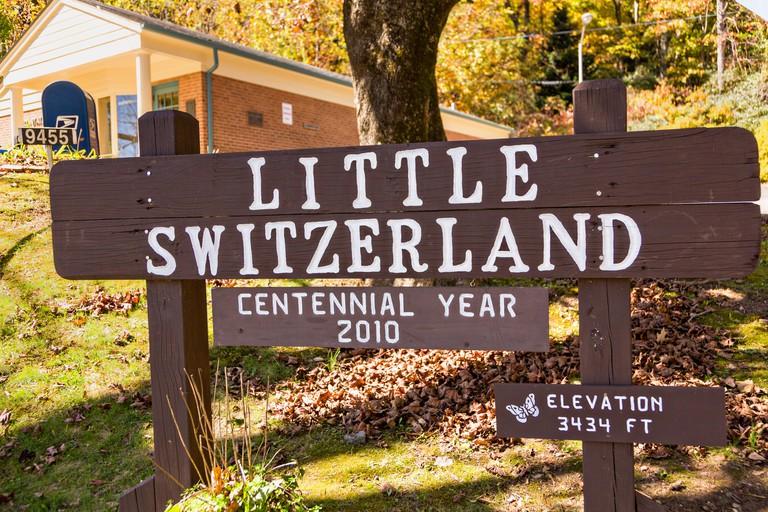 Sign marking the tiny hamlet of Little Switzerland, North Carolina.