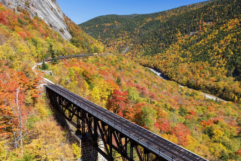 "Conway Scenic Railroad's ""Notch Train"" along the old Maine Central Railroad in Hart's Location, New Hampshire during the autumn"