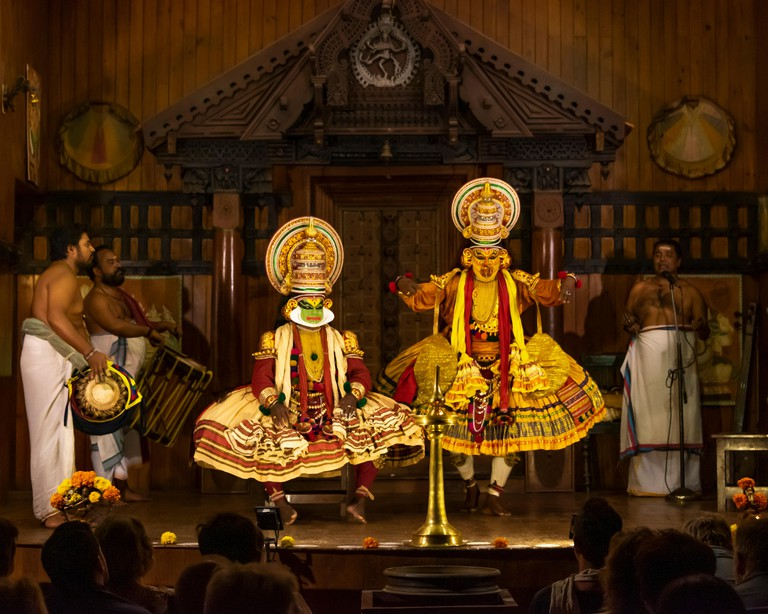 Horizontal view of a Kathakali performance in Kerala, India.