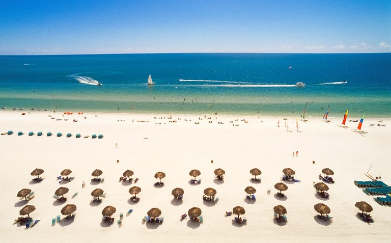 As seen here from the top of a high-rise resort hotel, wide sandy beaches and warm turquoise and azure waters of the Gulf of Mexico draw vacationers to Marco Island, a tropical barrier island near the Everglades in southwest Florida, USA. This playground