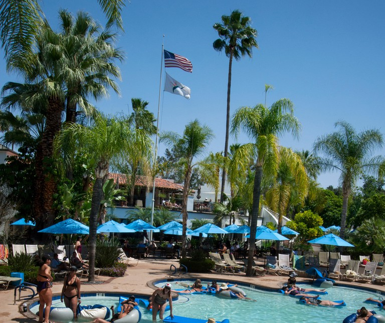 People floating on rafts in mineral hot springs pool at Glen Ivy Hot Springs, a day spa in Southern California near Los Angeles,