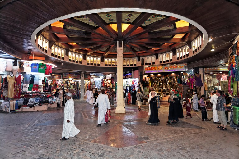 Customers and shops in the Muttrah Souq market, Muttrah, Muscat, Oman
