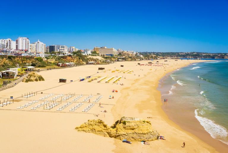 Sunbathers on Praia Da Rocha Beach Portimao Algarve Portugal EU Europe