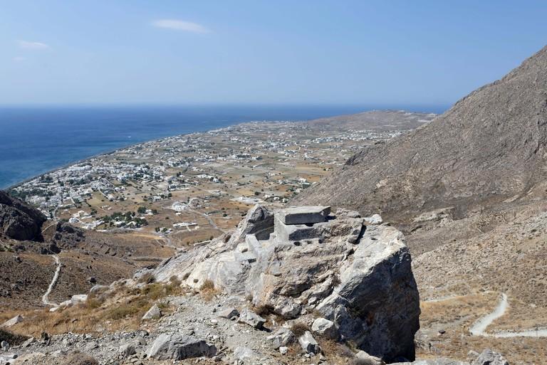 View from Ancient Thera on the summit of Mt Profitis Ilias of the coastal village of Perissa, Santorini, Greece. Located on the east coast of Santorin