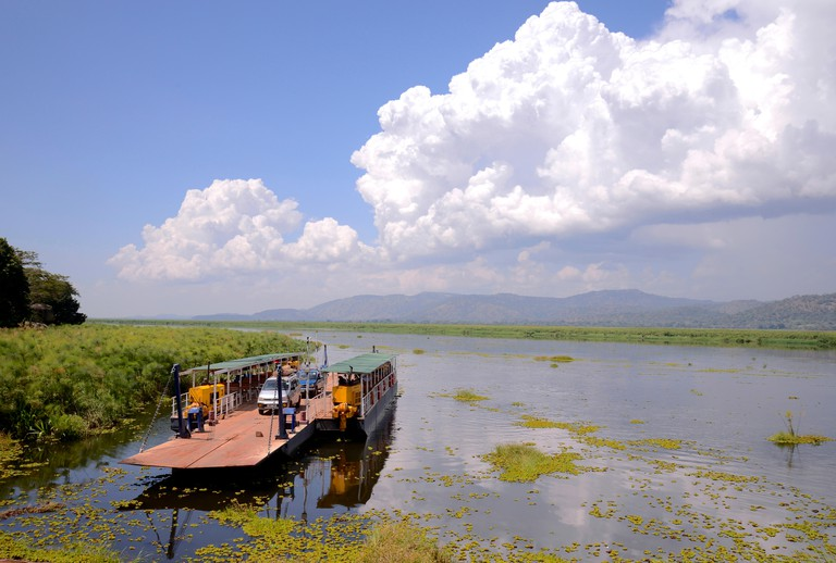 """Uganda is called """"The pearl of Africa"""" because of its beautiful landscapes, friendly people, and abundance of rain. Ferry crossing the Nile river"""