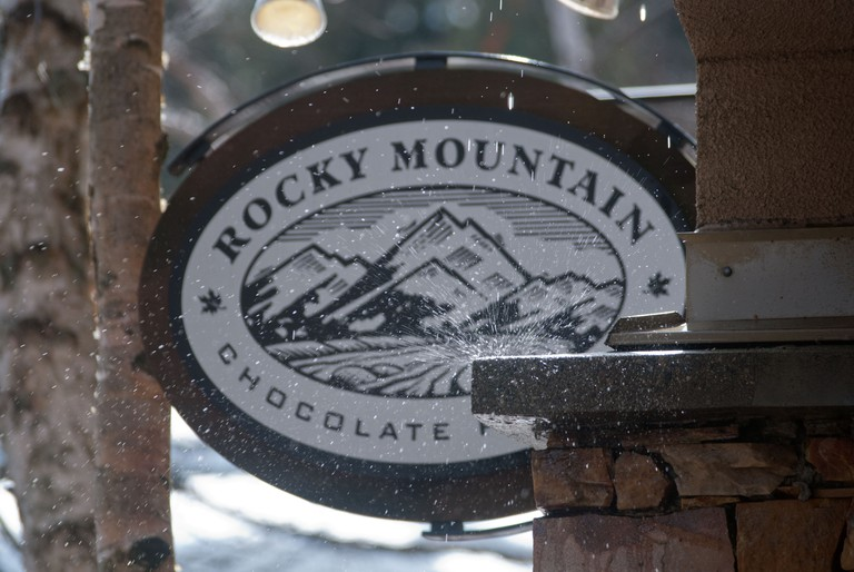 """""""Rocky mountain"""" shop signage in early spring as snow melts in Whistler Village, British Columbia, Canada"""