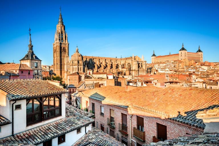 Toledo, Spain. Sunset HDR view of ancient city Toledo in Castilla la Mancha with Santa Iglesia Catedral and Alcazar.