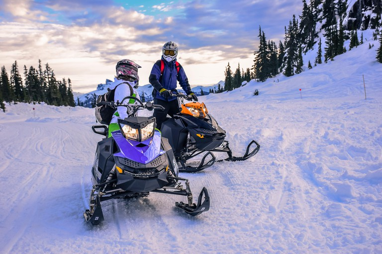 People talking while snowmobiling, Callaghan Valley, Whistler, British Columbia, Canada