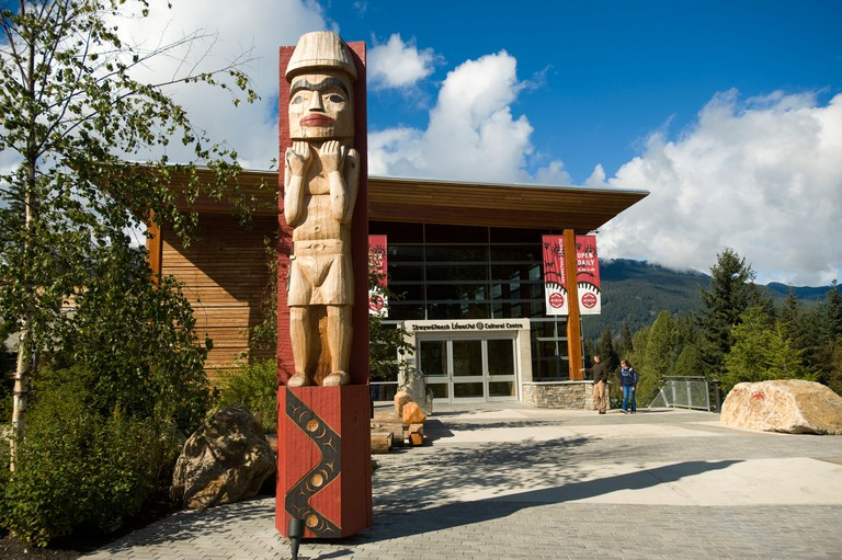 Totem poles in front of the Squamish Lil'wat Cultural Centre. Whistler BC, Canada
