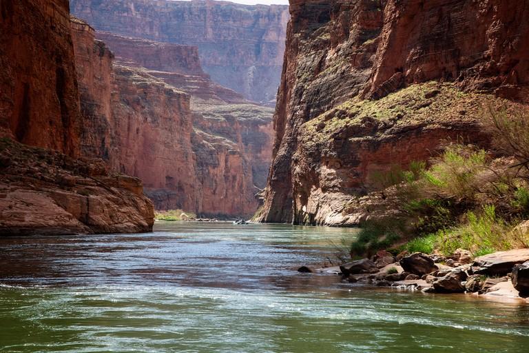 Rafting downstream from Red Wall cavern along the Colorado River, Grand Canyon, Arizona.