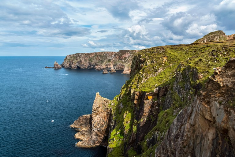 Steep cliffs along the coastline of Arranmore Island; County Donegal, Ireland