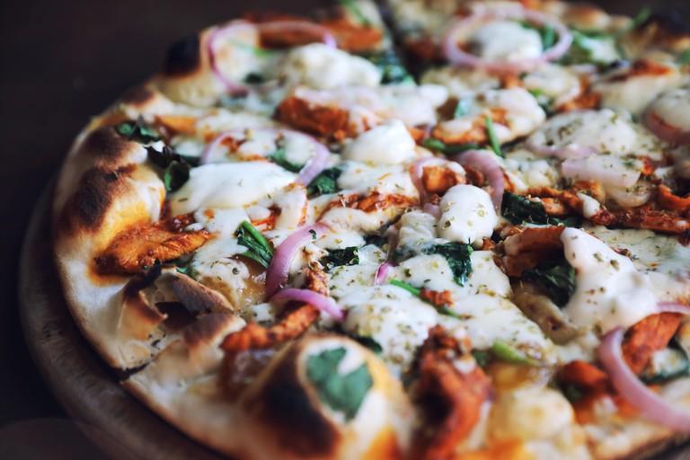 Tandoori Chicken Pizza on wooden table