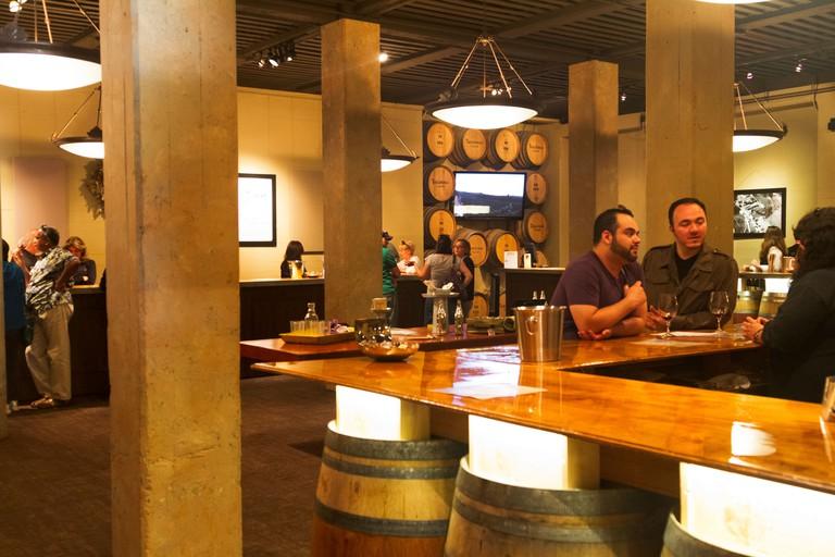 People wine tasting at Testa Rosa Winery in Los Gatos, California.