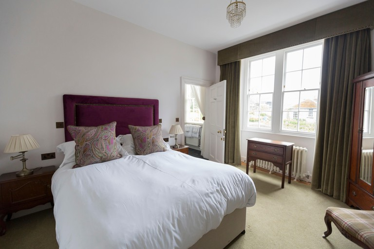 One of the plush double bedrooms in the accommodation available at Cardigan Castle, in the town of Cardigan, West Wales.