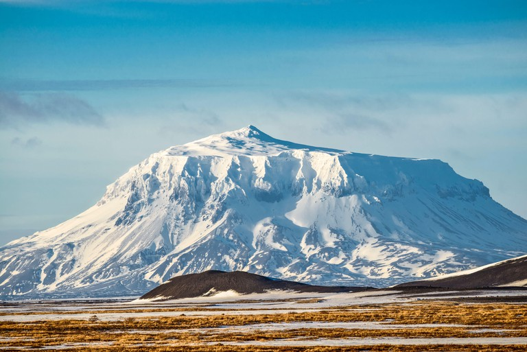 Mt Herdubreid in winter, snowcovered, seen from farm Moedrudalur located between lake Myvatn and Egilsstadir,  northeast Iceland.