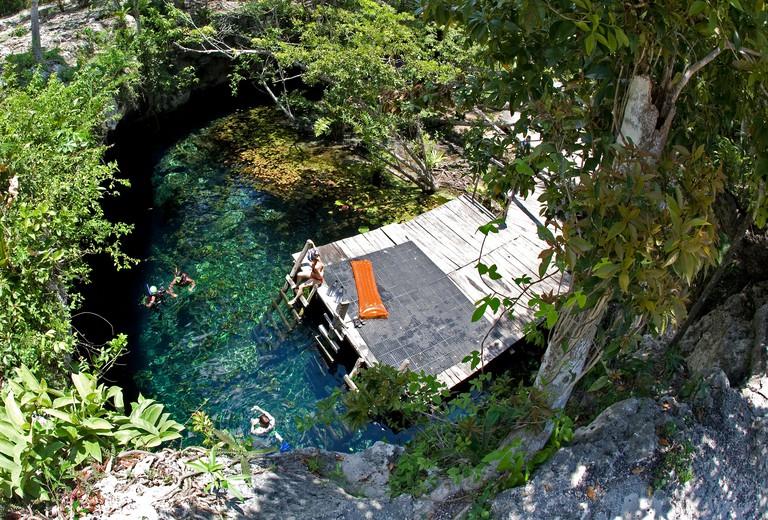 Snorkeler swimming in crystal clear water of Grand Cenote, Cenotes, Tulum, Riviera Maya, Yucatan, Quintana Roo, Mexico, Caribbean