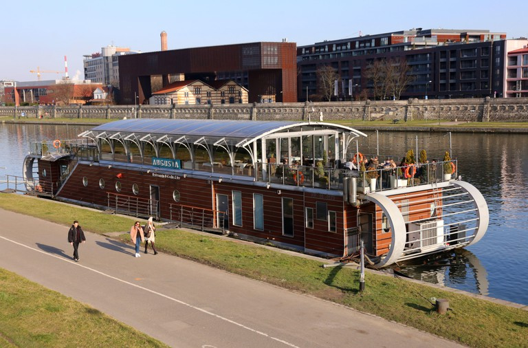 Cracow. Krakow. Poland. Vistula River waterfront boulevard. Barge restaurant