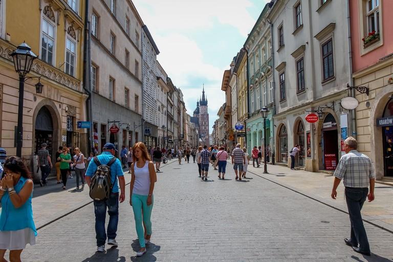 Krakow, Poland - July 29th 2018: Tourists walking down Florianska street in the old town of Krakow, Poland, near St.Florian's Gate