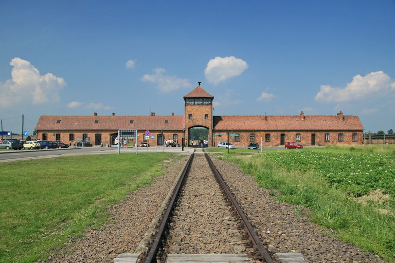 The railway track and main SS guard house at the former Nazi concentration camp at Auschwitz Birkenau.. Image shot 06/2007. Exact date unknown.