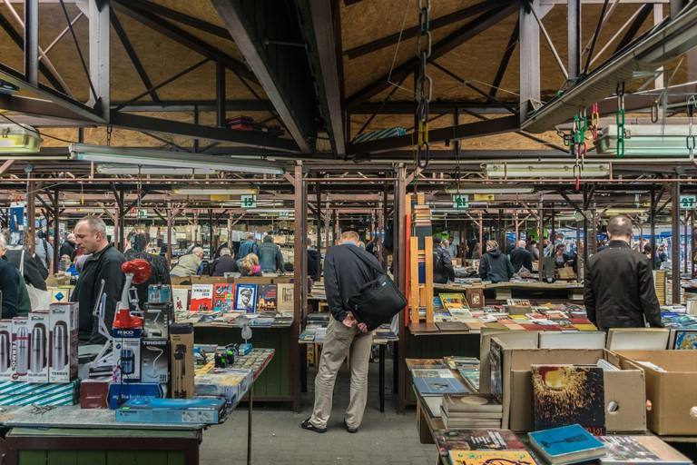 Krakow, Poland - September 21, 2018: Polish looking for Cheap second hand Books at Krakow's Unitarg plac targowy flea market