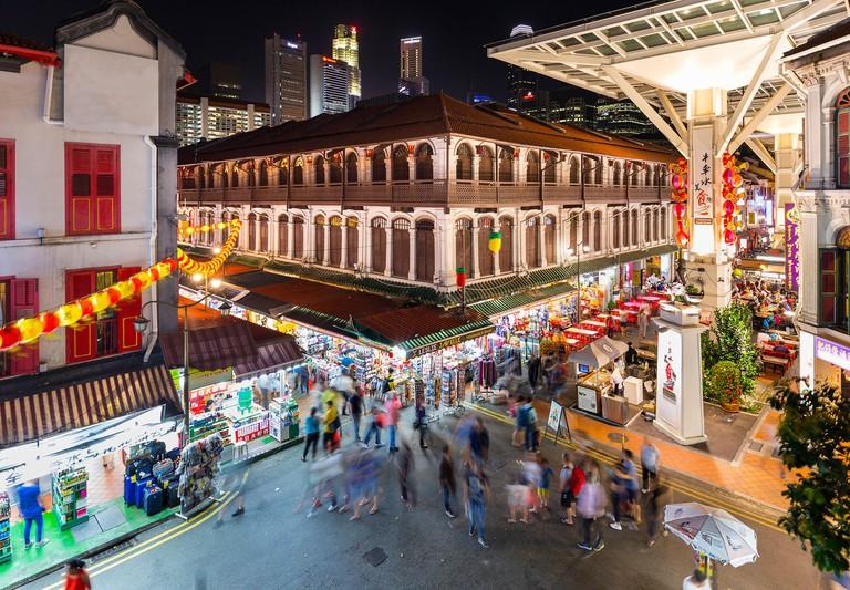 People at night at Chinatown Market, Singapore