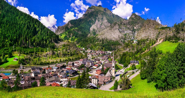 Beautiful Cortina D' Ampezzo village,view with cathedral,houses and mountains,Veneto,Italy.