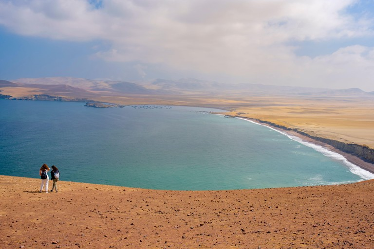 Peru coast, Mirador Istmo II, lookout at Paracas National Reserve protected area desert, ocean and red beach view landscape, Ica, Paracas, Peru
