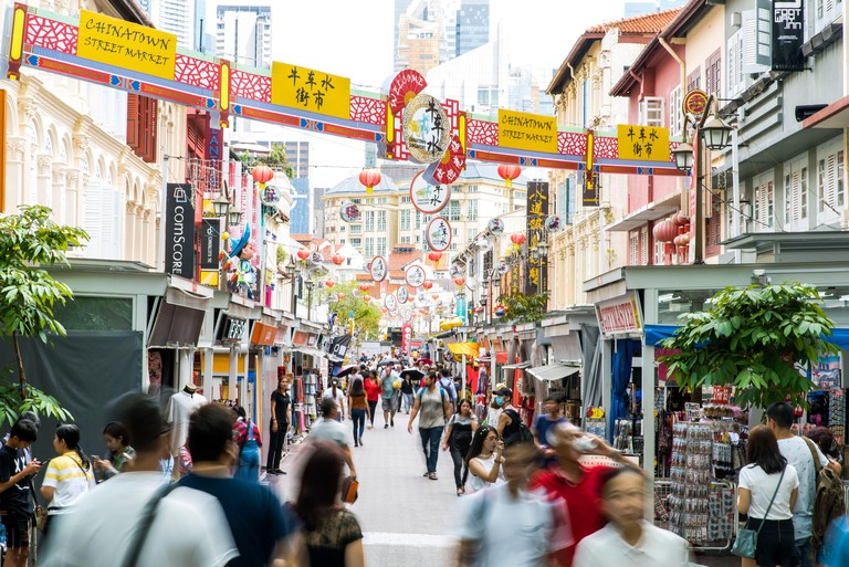 Singapore, Oct 2019: Busy, crowded street in Chinatown district. Chinese oriental decorations on street full of souvenir shops