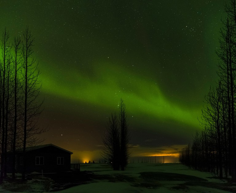 Northern Lights or aurora borealis over Laugardalur during winter in Iceland.    europe, northern europe, iceland,  February