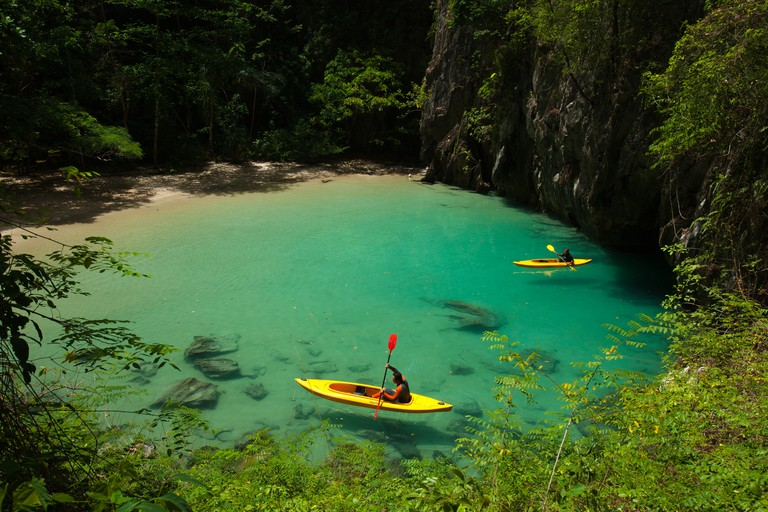 Tourist paddle their kayak inside cave in Trang province, south of Thailand.