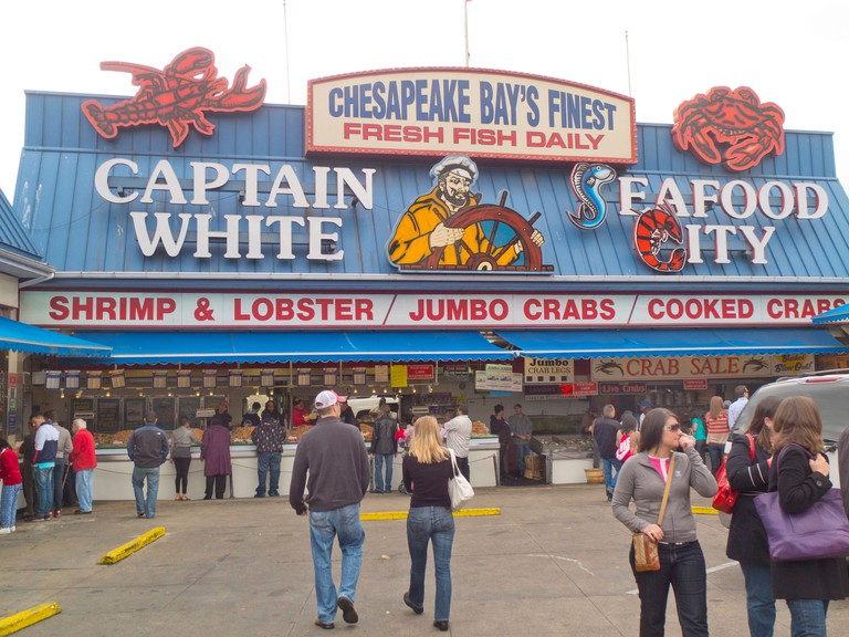 Captain White seafood city sign