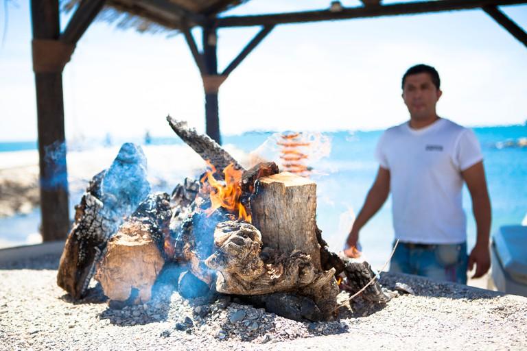 Cooking sardines on beach Malaga Spain