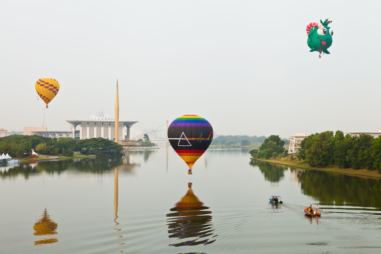 PUTRAJAYA, MALAYSIA - MARCH 2013 - One of the hot air balloon hovers over the river surface on March 2013 at Putrajaya. The annu