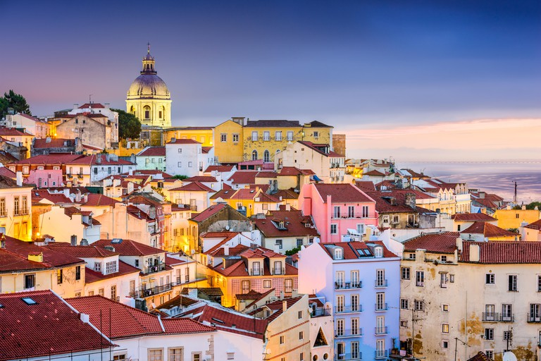 Lisbon, Portugal twilight cityscape at the Alfama District.