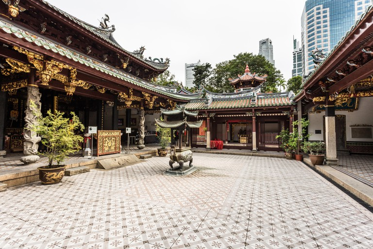 SINGAPORE, SINGAPORE The Thian Hock Keng Temple in Singapore, dedicated to both Buddhism and Taoism, contrasts with the modern t