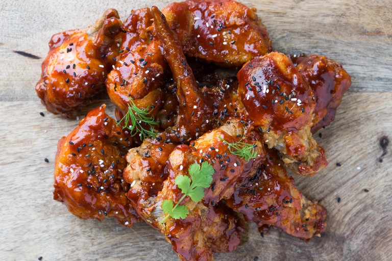 Delicious Home style Korean fried chicken with spicy sauce.