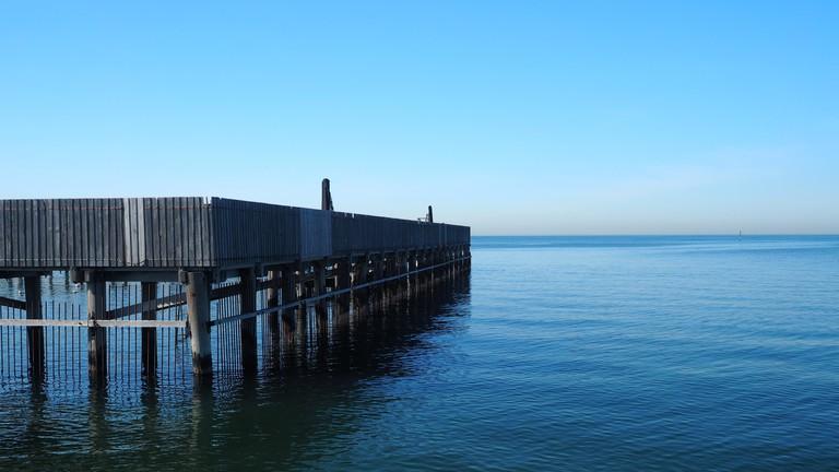 Brighton Baths and still ocean on a blue sky morning, Melbourne, Australia